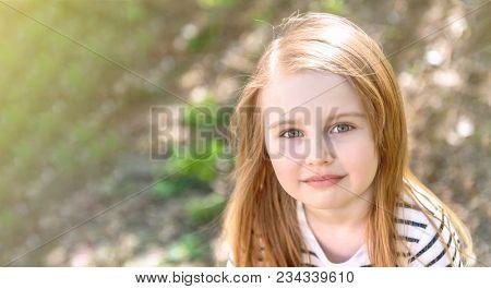 little girl with long hair, closeup