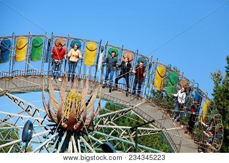 Russia, The City Of Bryansk, September 17, 2017. The Amusement Park Closes For The Season. People Ri