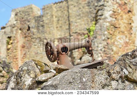 Rusty Abandoned Sewing Machine During World War 2 In Oradour Sur Glane France