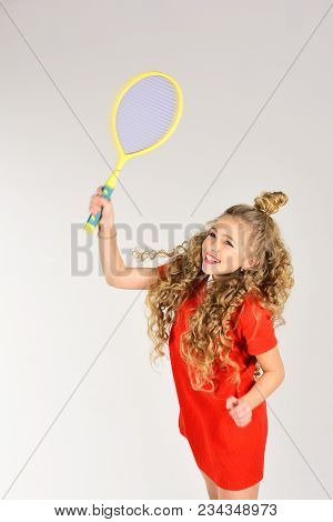 Practicing Tennis. Preparing To Big Game. Little Blond Hair Girl In Red Dress Hold Tennis Racket. Te