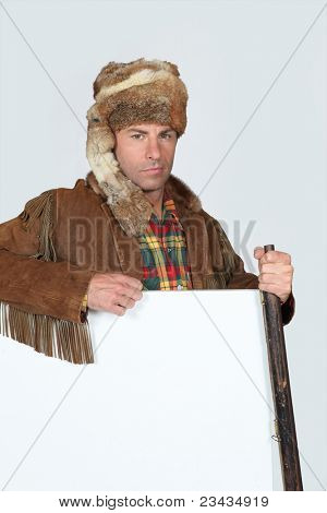 portrait of a man in trapper costume poster