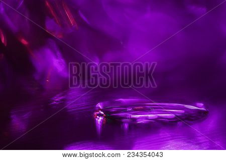 Drop Of Water On Glass Surface With Reflections Of Bright Colored Spots. Abstraction With Colorful B