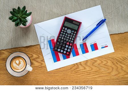 Accountant Workspace As Flat Lay From Above With Paperwork And Documents With Numbers  In Vertical B
