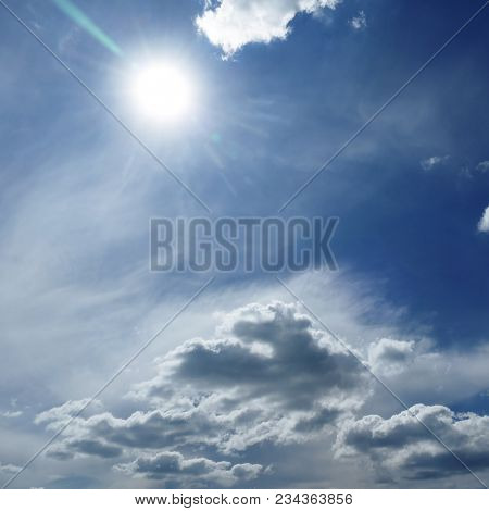 Natural bright sun on dark blue sky background.