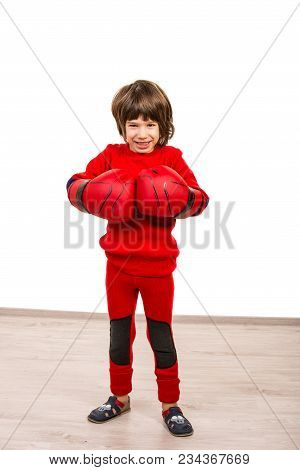 Strong Little Boy Showing Fists In Boxing Gloves  Against White Background