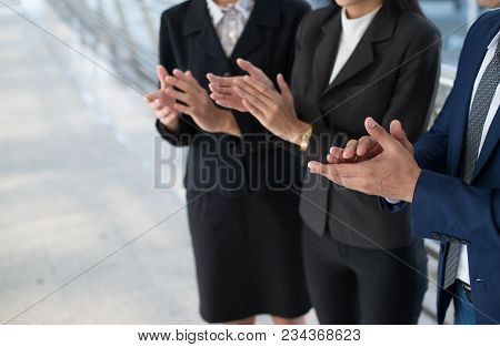 Business People Clap Their Hands To Congratulate The Signing Of An Agreement Or Contract Between The