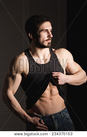 Perfect Man Shows His Six Pack Abs. Muscular And Fit Torso Of Young Male. Hunk With Athletic Body Ho