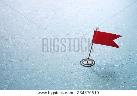Red Flag Pin In Target On Blue Textured Surface