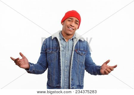 Handsome Black Man In Denim And Red Hat Holding Hands Apart Looking At Camera In Disbelief.