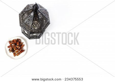 Ornamental Dark Moroccan, Arabic Lantern And Plate With Date Fruits On The White Table. Greeting Car