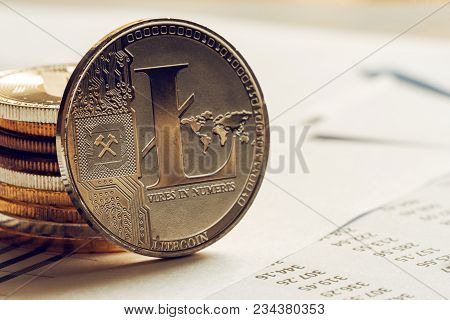 Litecoin Cryptocurrency Coinage On Business Office Desk, Selective Focus