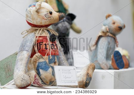 SAINT-PETERSBURG, RUSSIA - MARCH 22, 2018: Artistic dolls exposed on the exhibition TeddyFun 2018. The exhibition of designed Teddy Bears is held annually since 2011