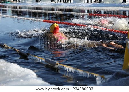 ST. PETERSBURG, RUSSIA - MARCH 4, 2018: Winter swimming competitions for Big Neva Cup. Winter swimmers from 12 countries aged from 12 to 78 take part in the competitions this year