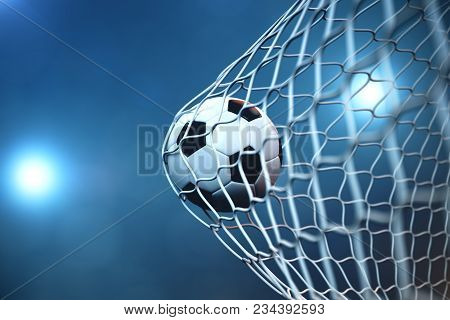 3d Rendering Soccer Ball In Goal. Soccer Ball In Net With Spotlight Or Stadium Light Background. Suc