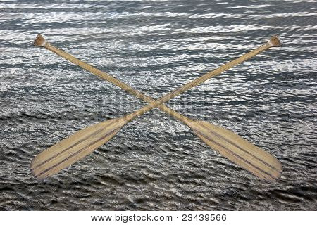 Wooden Canoe Paddles Crossed over Water