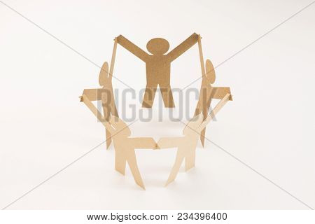 Closed Joining Of Five  Brown Paper Figure In Hand Up Posture On Bright White Background. In Concept