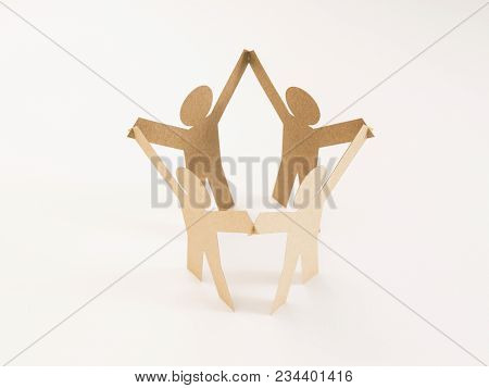 Closed Joining Of Four  Brown Paper Figure In Hand Up Posture On Bright White Background. In Concept
