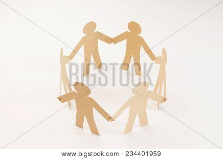 Closed Joining Of Six  Brown Paper Figure In Hand Down Posture On Bright White Background. In Concep