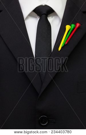 The Detail Of Wedding Suit With Golf Design.golf Tees In The Color Of Lithuania  Flag On The Flap Of