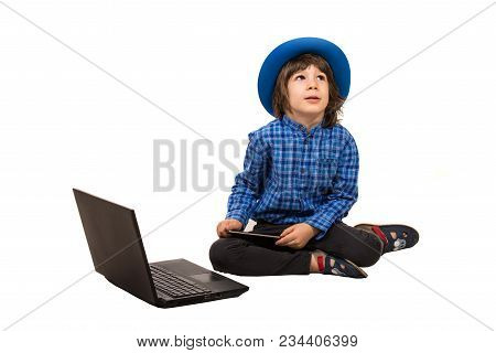 Little Elegant Boy  With Laptop And Smartphone Sitting Down And Looking Up Isolated On White Backgro