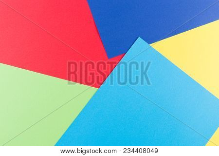 Color Papers Geometry Flat Composition Background With Yellow, Greenery, Red And Blue Tones.
