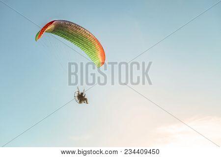 Flight On A Motorized Glider In The Blue Sky With Bright Backlight Sunlight. Solar Illumination Of T