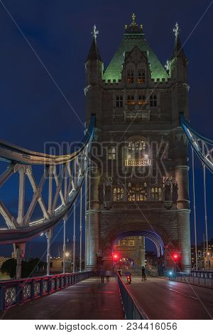 Tower Bridge In The Night Is Opening For Cruise And Is Closing For Cars Traffic , London, England.