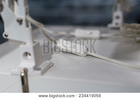 Electrical Light On - Off Switch For Lamp In White Plastic Case On White Table