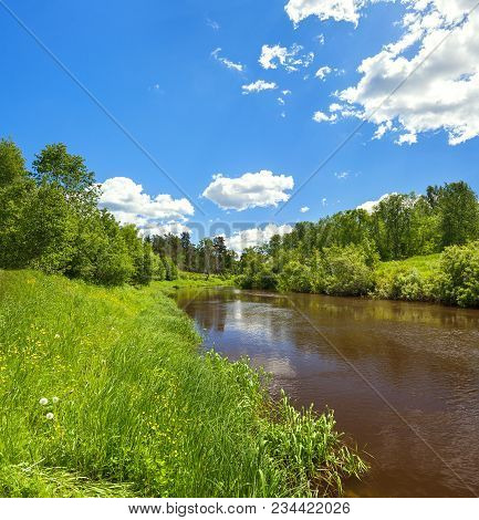 Beautiful Rural Summer Landscape With Forest, River, Blue Sky And White Clouds, A Panorama. Spring L