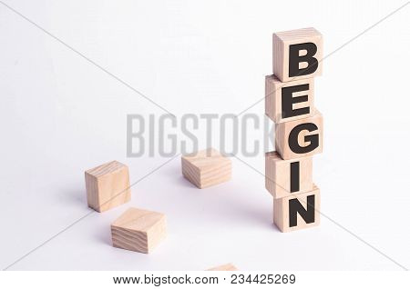 A Tower Of Squares And Cubes On A White Background With The Inscription Begin. The Beginning Of Some