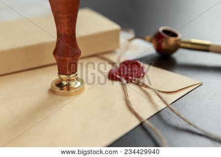 Notarial Wax Seal On Tied Scrolled Documents,