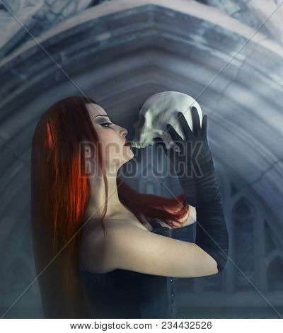 Young And Beautiful Gothic Woman With Red Hair In Black Corset And Gloves Holding And Kissing A Huma