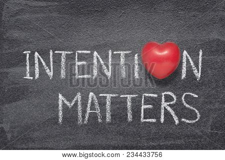 Intention Matters Phrase Handwritten On Chalkboard With Red Heart Symbol Instead Of O