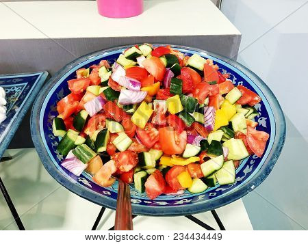 Fresh Salad From Lettuce Leaves Of Different Kinds Of Varieties Cabbage Carrots Rucola Salad. Sauce