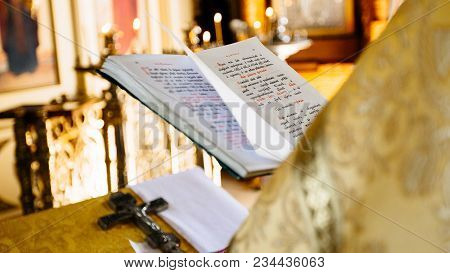Dnipro, Ukraine - August 06, 2017: Christian Priest Reading Church Book, Priest Reads A Pray Over Th