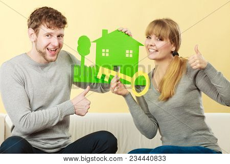 Property Ownership Finances Family Future Concept. Cheerful Couple Holding Cutouts. Young Man And Wo
