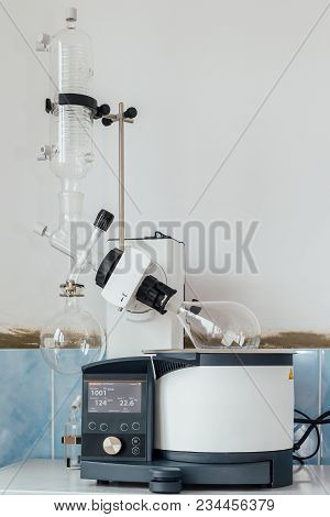 Modern working rotary evaporator in chemical laboratory poster