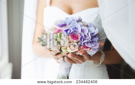 Wedding Bouquet Of The Bride In Hand. Beautiful Wedding Bouquet For Bride. Beautiful Wedding Bouquet