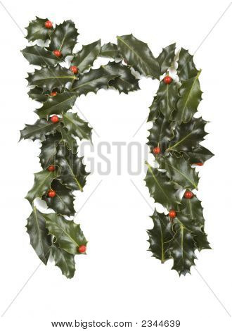 Holly Leaves with berry's in the form of the letter N. Isolated on white. poster