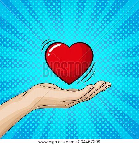 Hand Ist Holding A Big Red Heart. Pop Art Retro Vector Illustration.