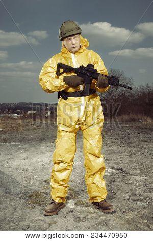 Freak Gunman Afraid Of Atomic War In Yellow Overall Watching Terrain Around