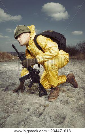 Freak Gunman Afraid Of Atomic War In Yellow Overall Watching Terrain
