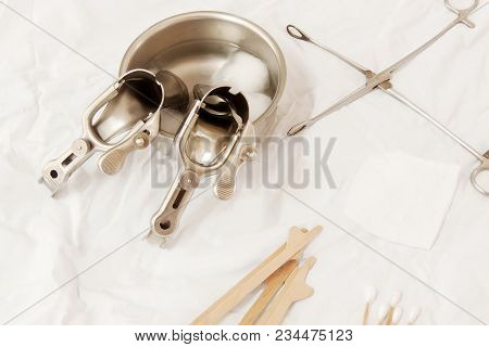 Vaginal Speculum Sterilized In Alcohol On Medical Instruments Table. Cervical Screening.