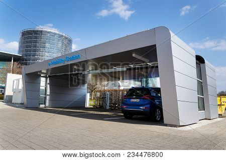 Dresden, Germany - April 2 2018: Volkswagen E-mobility Charging Station In Front Of The Glaserne Man