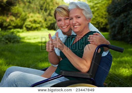 Disabled Woman And Nurse Holding Thumbs Up