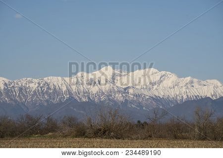 View of the snow-capped Mount Canin in winter poster