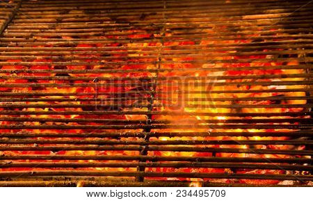 Glowing And Flaming Hot Natural Wood Charcoal In Street Food Bbq Grill Stove Background.