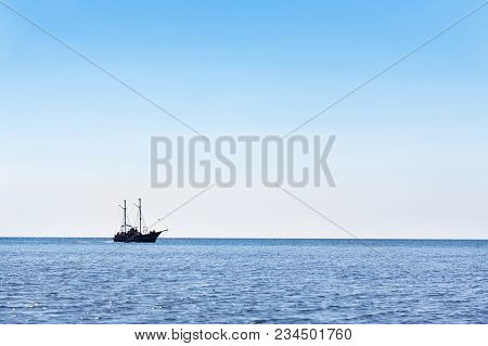 Sailing Ship The High Seas On The Horizon In Good Weather On A Background Of Blue Sky. Marine Backgr