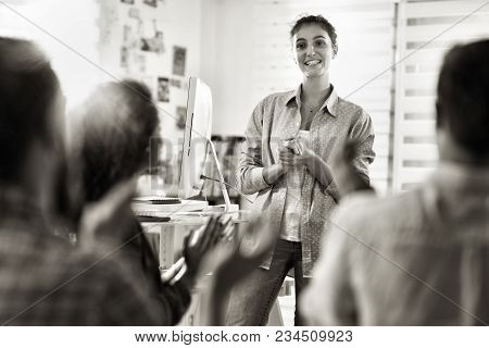 In A Modern Company. A Young Woman Has Just Finished Presenting Her Project. She Is Applauded By Her