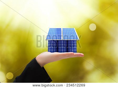 solar panel on hand. solar battery roof/ Green lights background
